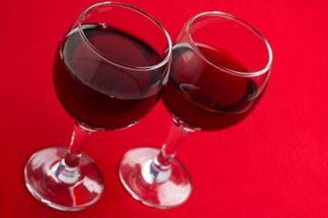 Two glasses with red wine.