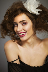 Portrait of a beautiful woman with long brown hair and makeup