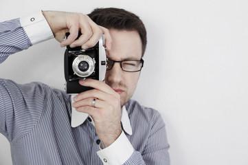 photographer using film camera