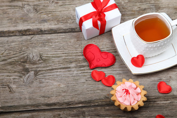Cup of tea, cake and red heart