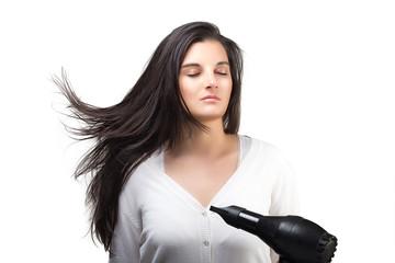 Beautiful Young Woman Using Hair Blower. Healthy Long Hair