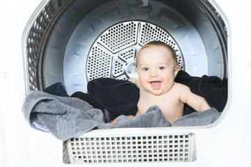 Little baby in the washing machine
