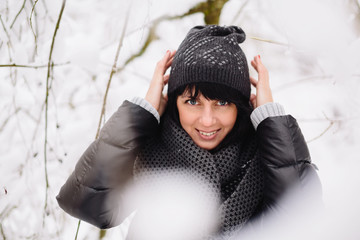Portrait of a beautiful girl in winter forest