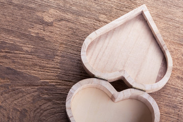 heart brown wood box on wood background, abstract love