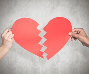 Wall Mural - Composite image of two hands holding broken heart