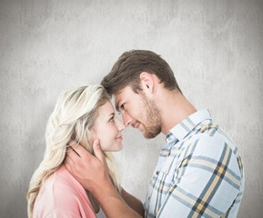 Composite image of attractive couple smiling at each other
