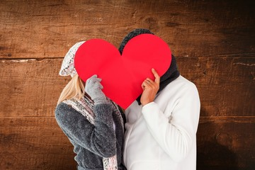 Wall Mural - Couple in winter fashion posing with heart shape