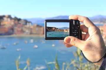 man taking picture of Silence bay to Sestri Levante