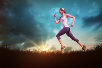 Composite image of pretty fit blonde jogging