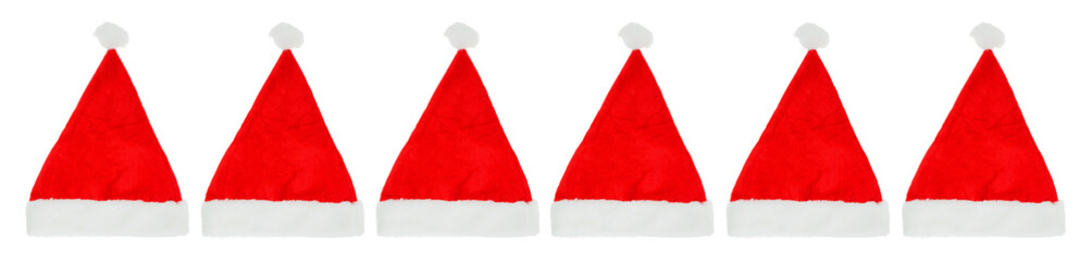 Row of Christmas Santa hats on a white background