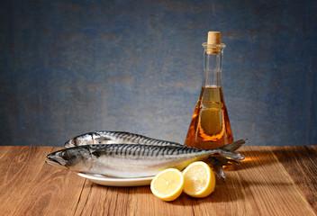 Fresh fish mackerel, lemon and wine in the bottle