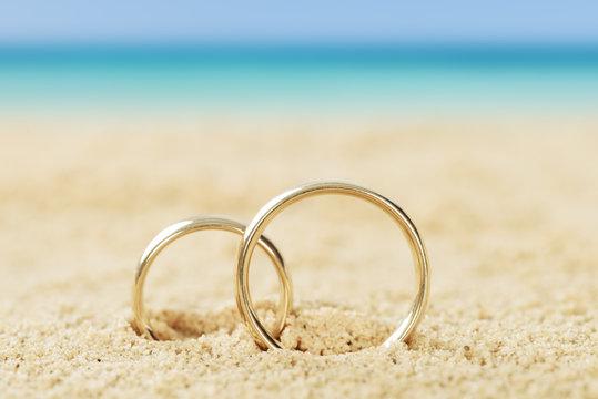 Wedding Rings On Sand