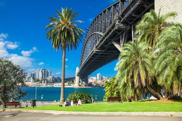 People in front of Harbour bridge in Sydney, Australia.