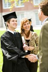 Graduation: Teacher Congratulates New Graduate