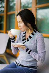 Woman eating a delicious coffee