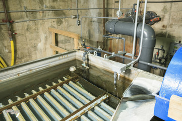 Wastewater aeration basin bubbling in a building