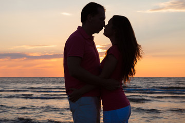Couple About To Kiss At Beach During Sunset