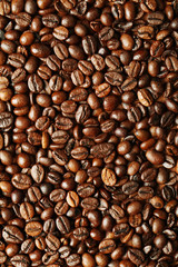 Brown coffee beans, close-up of coffee beans for background and