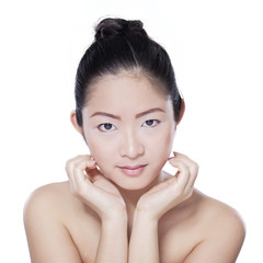 Woman with beautiful face after facial treatment