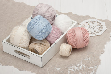 Thread Bobbins in a Wooden Tray. Natural Linen Napkin with Croch