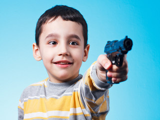 Boy and plastic gun
