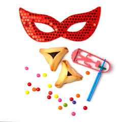Hamantaschen cookies, grogger and carnival mask
