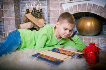 boy in the interior of the fireplace, winter evening,