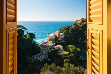 View of the hills surrounding Portofino seen through a window