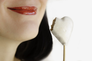 lips and heart-shape cookie isolated