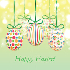 Set of colorful Easter eggs with green ribbons