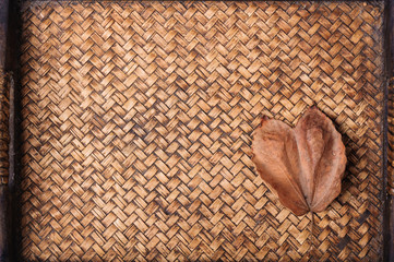 Green leaf on hand work bamboo texture