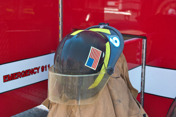 firefighter's helmet on coat