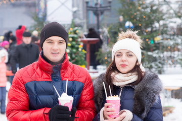 Young Couple Having Winter Cup Drinks