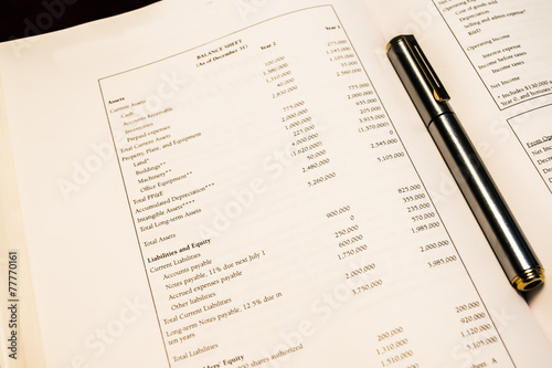 standard balance sheet with pen stock photo and royalty free images