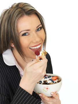 Young Business Woman Eating a Bowl of Cereals with Yogurt and Be