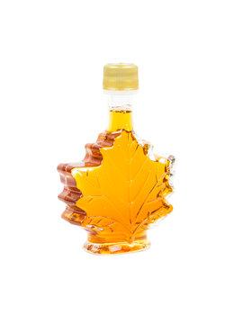 Leaf shape maple syrup bottle on white background