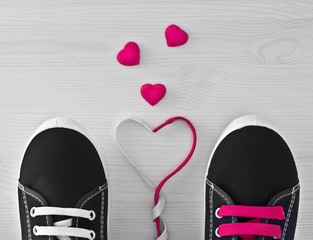 Sneakers with colorful laces. The idea of Valentine's Day