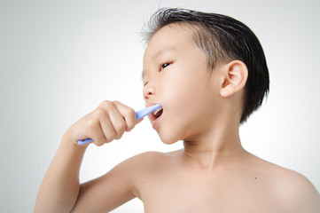 Boy brush his tooth