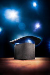 Wall Mural - High contrast image of magician hat on a stage
