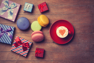 Cup and gift boxes with macaron