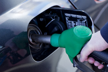 filling up the  car with fuel at petrol station