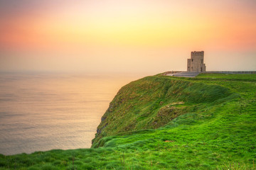 Wall Mural - Tower on the Cliffs of Moher at sunset, Ireland