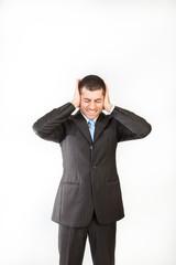 Man hiding his ears