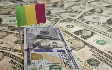 Flag of Mali sticking in various american banknotes.(series)