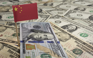Flag of China sticking in various american banknotes.(series)
