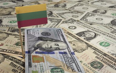Flag of Lithuania sticking in various american banknotes.(series