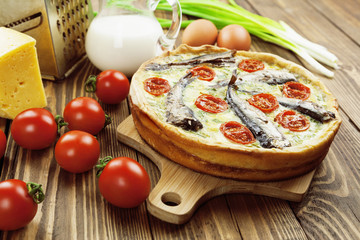 Kish with sprats and cherry tomatoes
