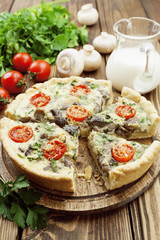 Kish with mushrooms and cherry tomatoes