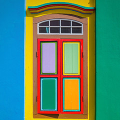 Colorful window and details on a colonial house in  Singapore