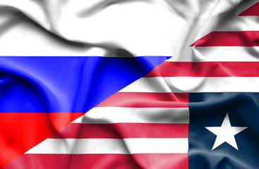 Waving flag of Liberia and Russia